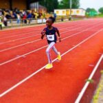 pupil taking part in race on track
