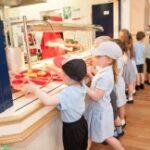 children queuing for school meals